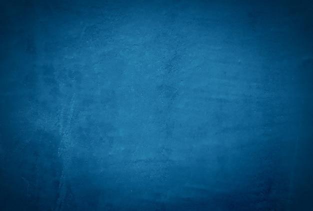 Priorità bassa della parete di struttura di cemento blu grunge vintage con vignetta.