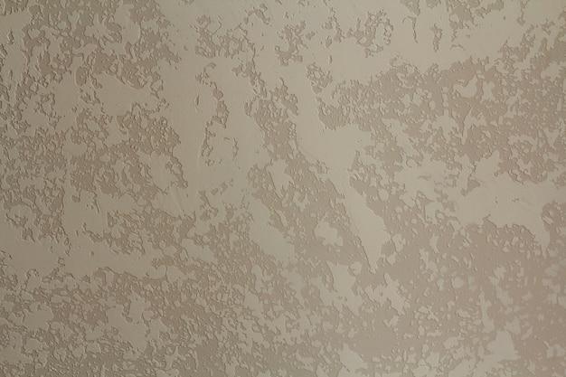 Priorità bassa grigia del grunge o dell'annata di cemento naturale o vecchia struttura di pietra come retro parete del reticolo.