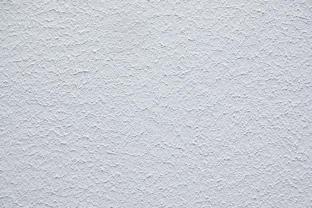 Sfondo bianco vintage o grungy di cemento naturale o vecchia struttura di pietra come un muro modello retrò. è uno striscione murale concettuale, concettuale o metafora
