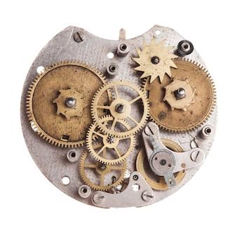 Meccanismo di orologi meccanici vintage isolato su bianco