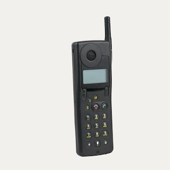 Telefono cellulare vintage con schermo lcd isolato su superficie bianca