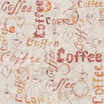 Vecchia superficie di caffè in carta vintage con scritte, cuori, tazze da caffè e tracce di tazze