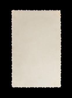 Carta fotografica d'epoca su sfondo nero. cornice vuota