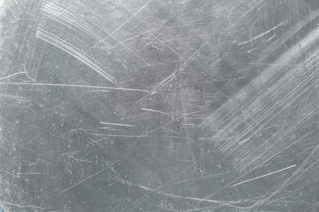 Texture vintage di piastra di ferro, ammaccature e graffi sullo sfondo della superficie metallica