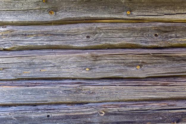 Sfondo di legno vintage con vernice scrostata orizzontalmente