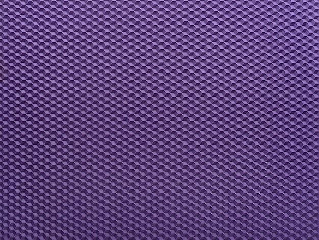 Trama di sfondo viola a nido d'ape. sfondo astratto geometrico. modello.