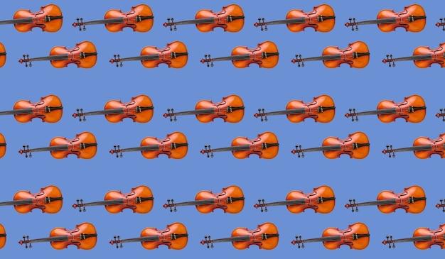 Modello senza cuciture di violino su sfondo blu. strumento musicale violino senza cuciture. concetto minimalista della musica. stampa violino