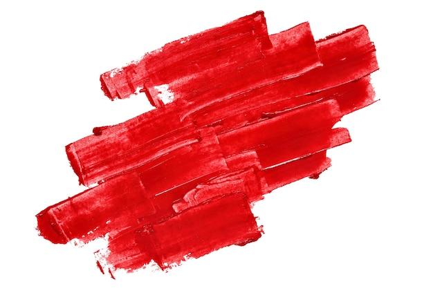 Pennellate con texture rosso vivo isolate su sfondo bianco