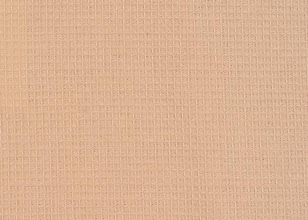 Tessuto beige waffle con spazio copia trama visibile per testo, elementi di design di stampa web. Foto Premium
