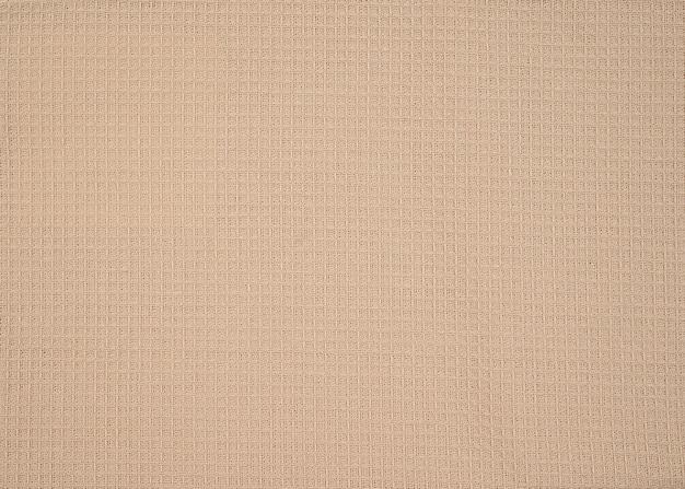 Estratto di cotone waffle. tessuto waffle di cotone naturale, trama di stoffa
