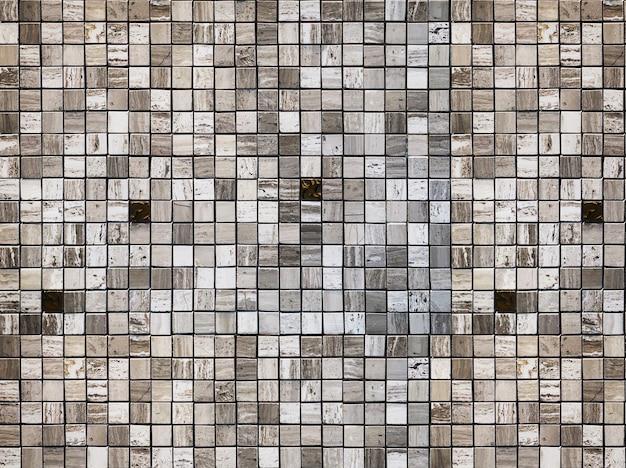 Sfondo muro. motivo geometrico in pietra di marmo quadrato per interni dal design moderno.