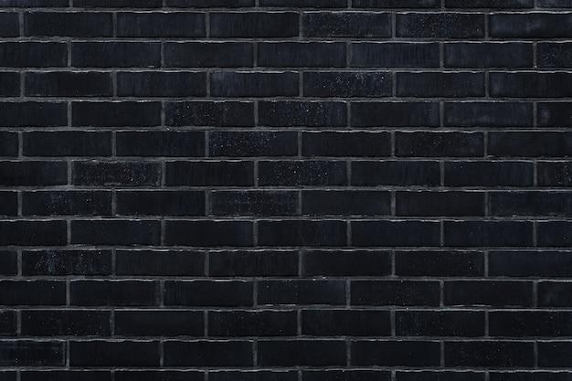 Muro di mattoni neri sfondo texture per il design
