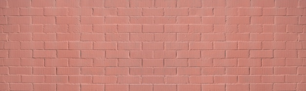 Muro di mattoni dipinti in color salmone