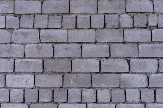Muro di blocchi di cemento come sfondo e strutturato