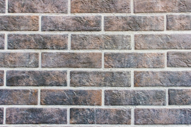 Muro fatto di mattoni neri marrone scuro
