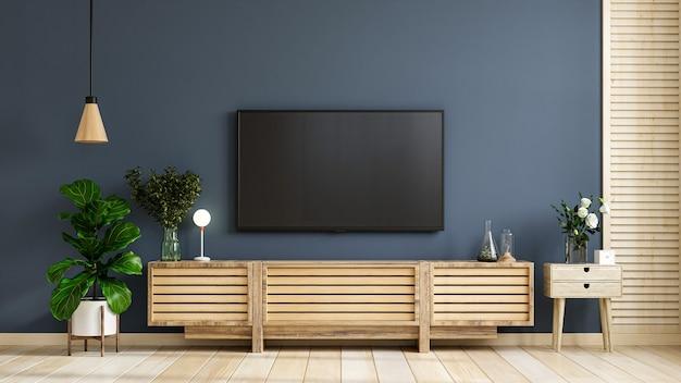 Tv montata a parete su mobile in una moderna stanza vuota con dietro la parete blu scuro. rendering 3d