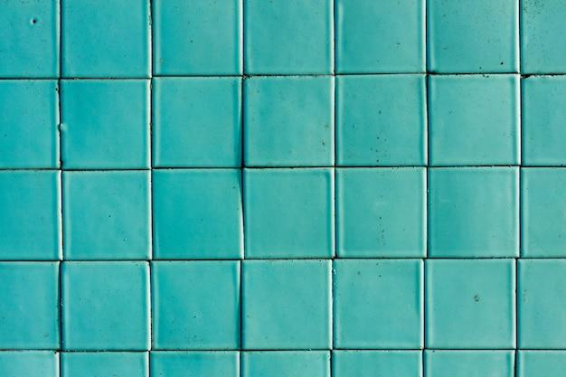 Muro di vecchie piastrelle quadrate blu. sfondo per il design. foto di alta qualità