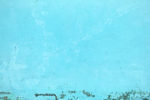 Colore turchese della struttura della parete, primo piano della struttura in calcestruzzo come sfondo urbano