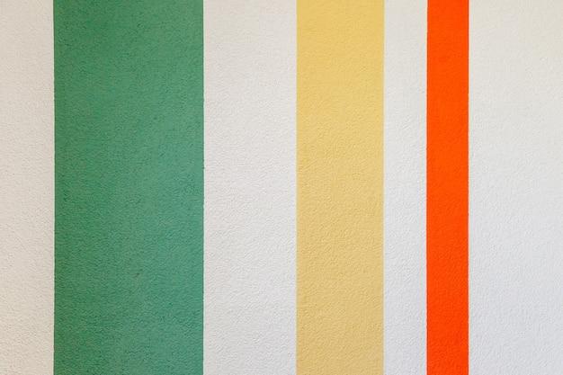 Struttura della parete con linee verticali verde, rosso, giallo