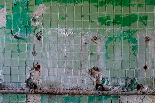 Parete con vecchio mosaico. sfondo per il design. foto di alta qualità