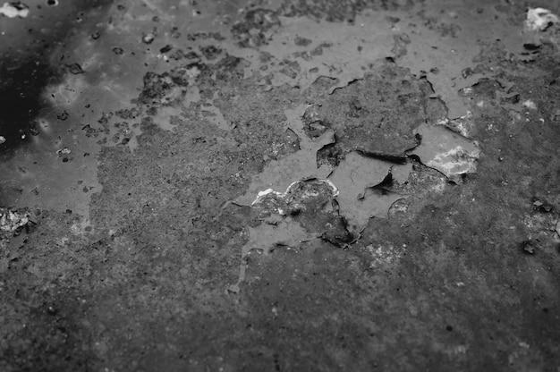 Muro con ruggine. superficie di metallo arrugginito. trama di ferro arrugginito. colore nero tonico