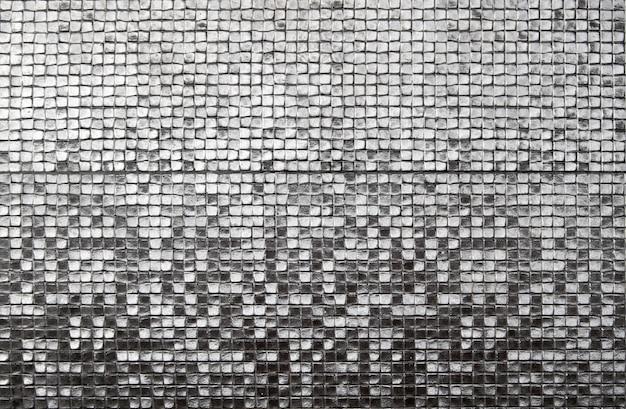 Le pareti sono decorate con argento di piastrelle, texture di sfondo