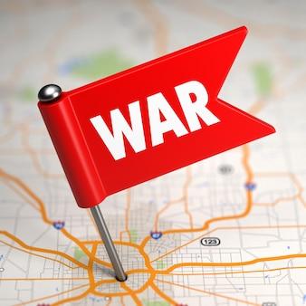 Concetto di guerra - piccola bandiera su uno sfondo di mappa con messa a fuoco selettiva.