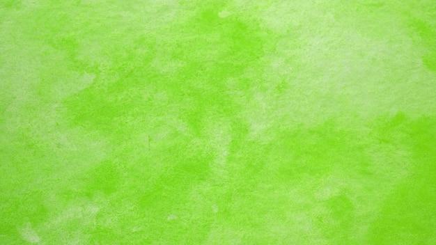 Il fondo dell'acquerello, pittura verde astratta dell'acquerello di arte ha strutturato la progettazione sul fondo del libro bianco