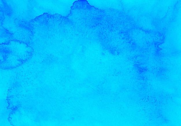 Acquerello blu texture di sfondo dipinto a mano. macchie di turchese dell'acquerello su carta.