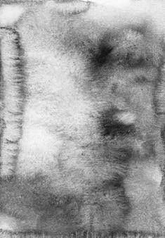 Trama di sfondo grigio calma dell'acquerello. macchie monocromatiche su carta.