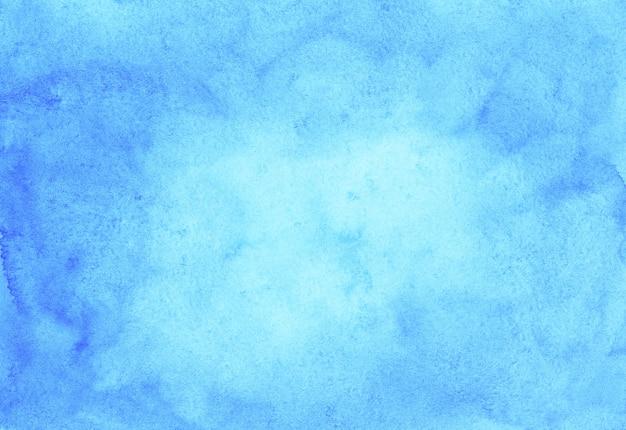 Acquerello sfondo azzurro trama dipinta a mano. macchie blu cielo dell'acquerello su carta.