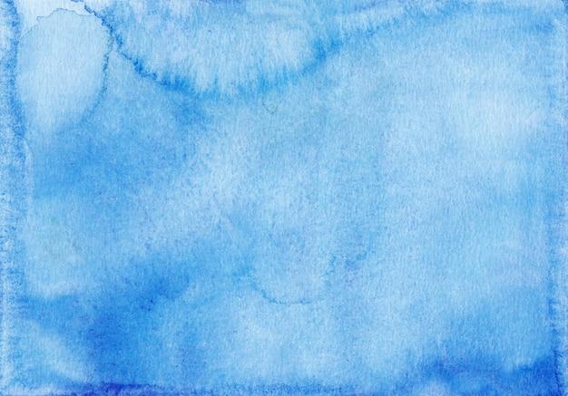Trama di sfondo azzurro dell'acquerello. macchie blu cielo dell'acquerello su carta.