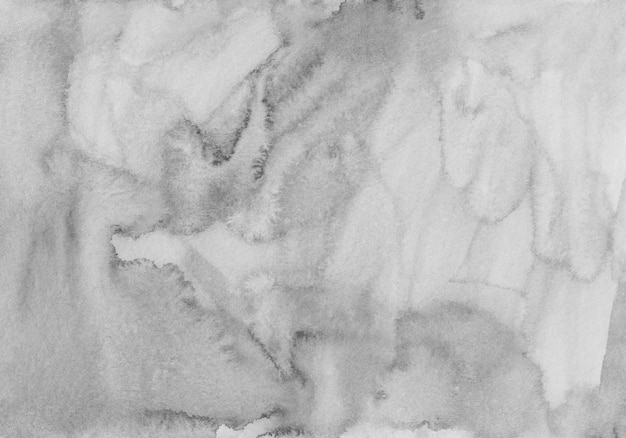 Trama di sfondo grigio chiaro dell'acquerello. sfondo monocromatico aquarelle. macchie sulla carta.