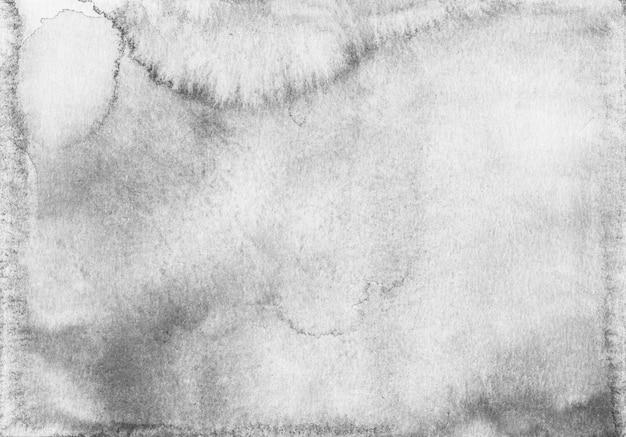 Trama di sfondo grigio chiaro dell'acquerello. macchie grigie sul rivestimento in carta.
