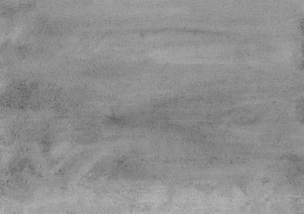 Trama di sfondo grigio chiaro dell'acquerello. sfondo bianco e grigio. macchie grigie sul rivestimento in carta.