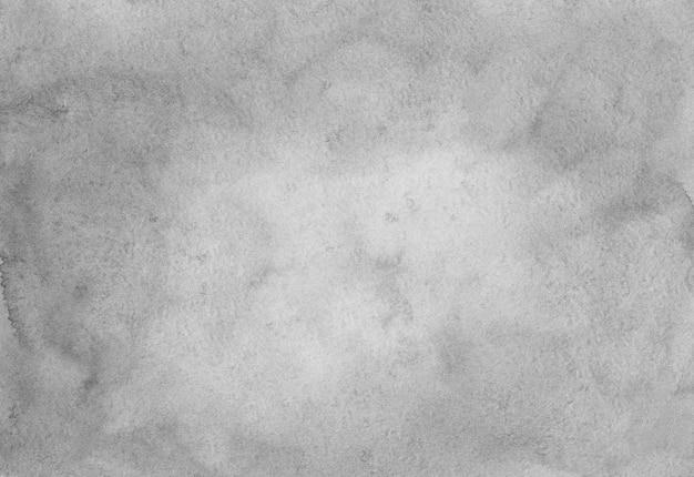 Trama di sfondo grigio chiaro dell'acquerello. sfondo bianco e grigio con spazio per il testo. macchie grigie sul rivestimento in carta.