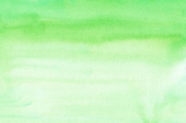 Acquerello verde chiaro ombre texture di sfondo. sfondo sfumato verde pastello aquarelle. modello orizzontale.