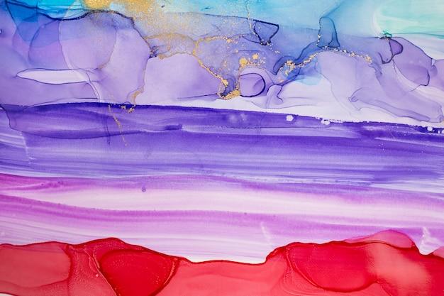Acquerello rosso e viola astratto sfondo sfumato con polvere d'oro