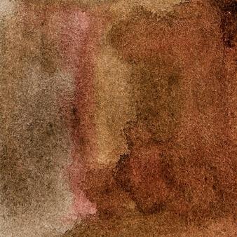 Uno sfondo acquerello rosso-marrone con macchie e striature, pennellate e macchie