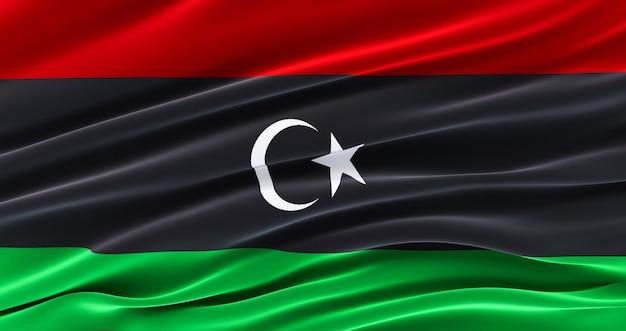 Sventolando la bandiera in tessuto della libia