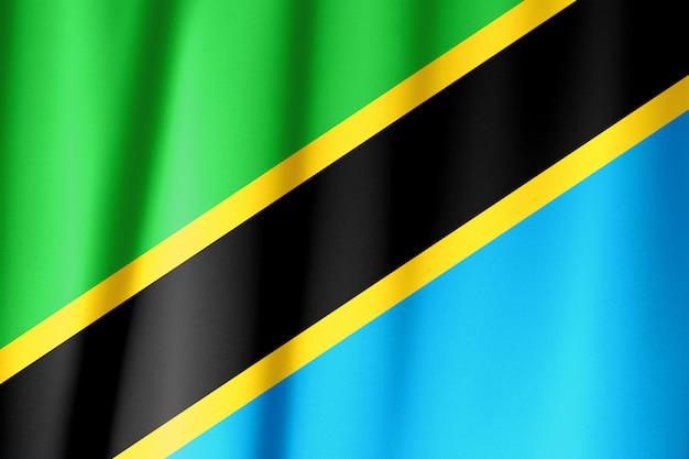 Sventolando la bandiera della tanzania. la bandiera ha una vera trama del tessuto.