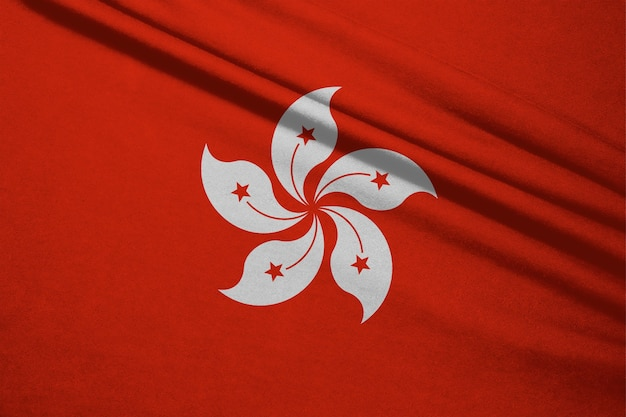 Tessuto ondulato della bandiera di hong kong. hong kong è uno stato della cina. Foto Premium