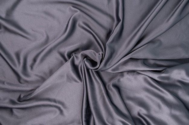 Superficie ondulata in tessuto di raso di seta grigio blu viola ondulato