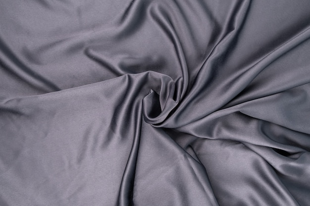 Tessuto ondulato in raso di seta grigio blu viola ondulato