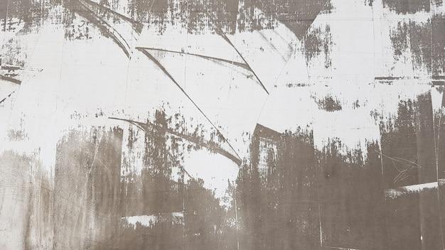 Muro di cemento stagionato e invecchiato con vernice, per lo più pelato dal bianco e nero con vignettatura. sfumature di grigio e bianco. grande sfondo moderno e strutturato. vecchio fondo astratto.