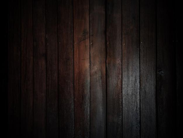 Fondo di legno vecchio fienile stagionato con nodi