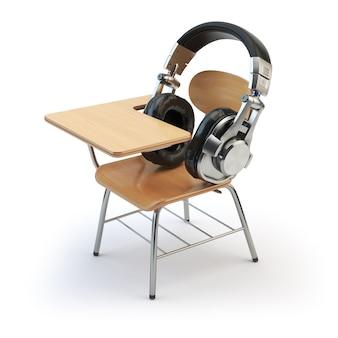 Webinar training o concetto di audiolibri cuffie e banco di scuola isolato su bianco 3d