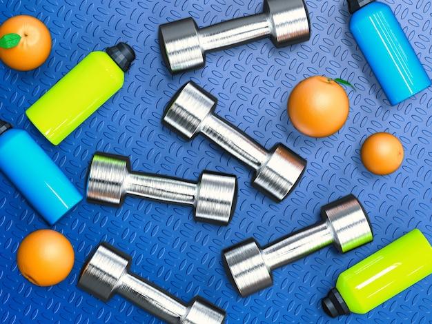 Peso e concetto di dieta con manubri in metallo e sfondo di arance