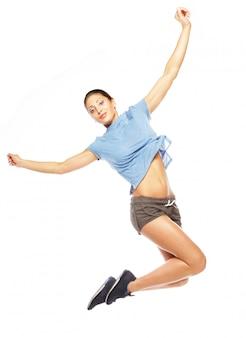 Donna di forma fisica di perdita di peso che salta di gioia.