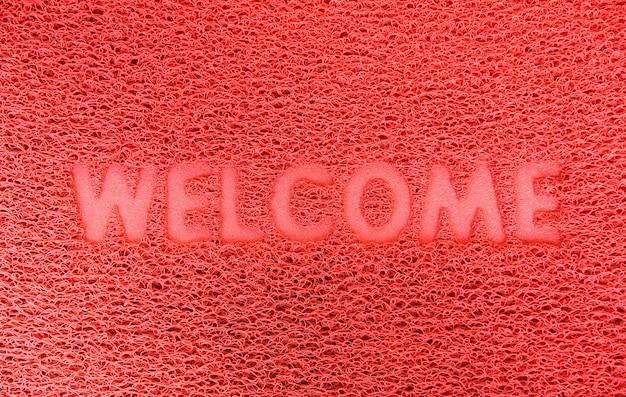Benvenuti in plastica porta rossa capet sfondo texture